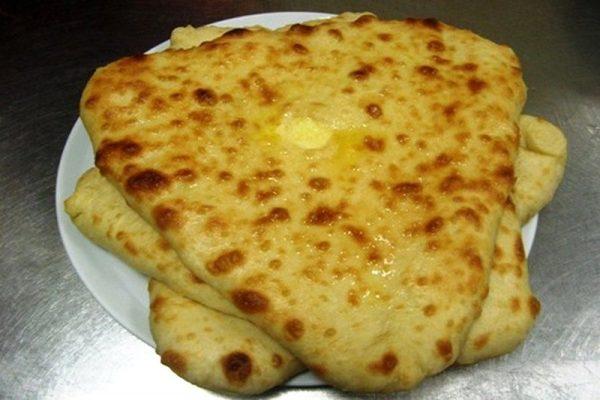 Артадзыхон - ритуальный пирог с сыром треугольной формы